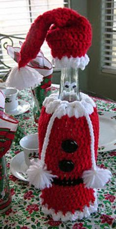 6 Holiday Wine Bottle Buddies Patterns Santa Wine Bottle Cover Cozy Free Crochet Pattern The post 6 Holiday Wine Bottle Buddies Patterns appeared first on Crafts. Crochet Christmas Cozy, Crochet Mug Cozy, Crochet Santa, Christmas Crochet Patterns, Christmas Knitting, Crochet Gifts, Christmas Crafts, Christmas Ornaments, Free Crochet