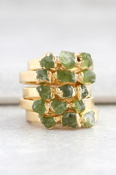 Stacks of green peridot rings for the perfect April birthday gift.