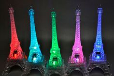 LED Eiffel Tower Light Up Statue Color Changing  Perfect for centerpieces, wedding decoration, party decoration, home decor, party supplies, Cake Topper, table pieces and diy crafts, Night Light  Light up Eiffel Tower - ON/OFF switch, easy push button control - Multi-Color Light Function - 3XLR44 Button batteries (Replaceable)   What does this Mean. You can select one color to stay on Or You can select multi colored which it will rotate through the colors on its own.  4 Inches x 4 Inches x…