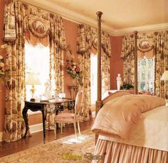 The large windows in this generously proportioned bedroom can take an elaborate, weighty treatment of gathered balloon shades, floor-length panels, and shaped and gathered valances