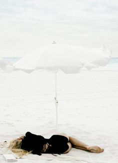 summer. Taking naps under a beach umbrella feeling the breeze.