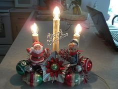 Upcycled vintage Christmas Candolier craft I mad using vintage Santa, Elf and Shiny Brite ornaments