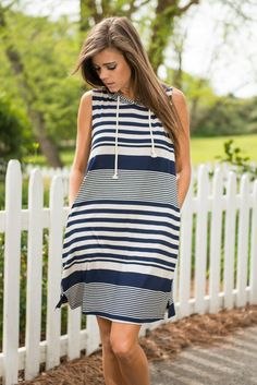 Shoreline Sweety Dress, Navy || This dress has casual down to a t!! We love the nautical feel it has! This dress would be perfect for any time you are going to be around a body of water! Or just having to run errands! It even has a drawstring hood you can put up if you need a little protection from the wind!