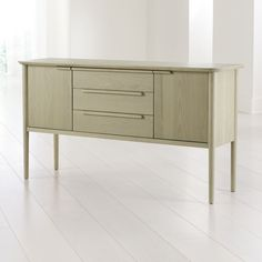 Shop Tate Sand Midcentury Sideboard. Our 1960s-inspired Tate sideboard recalls the timelessness of mid-century design with a tailored profile and streamlined shape.