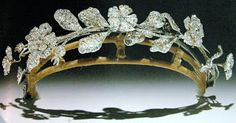 A diamond tiara in the form of wild roses and carnations. The flowers are mounted 'en tremblant' and so are animated at any movement of the head. This is said to have been owned by Lady Caroline Lamb. The flowers chosen stand for a woman's true love, curiously appropriate since her life was blighted by her love for Lord Byron.