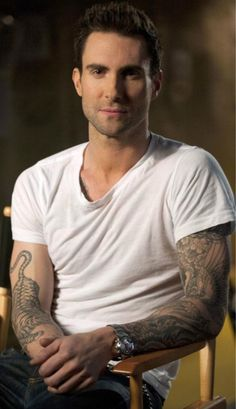 (Why would I add him to my hairstyles board, you ask? Well wouldn't YOU want him all up in your hair too?)  Adam Levine