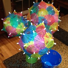 Umbrella centerpiece balls for Baby Frangers 'Umbrella' themed shower! Cheap, easy, and fabulous my favorite kind of craft!
