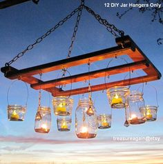 Make a charming chandelier with wooden pallets and hang mason jar candle lanterns on it for a spring evening garden party!