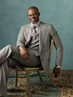 Djimon Hounsou. The gray suit and the salt and pepper goatee. Looking every bit the Statesman.