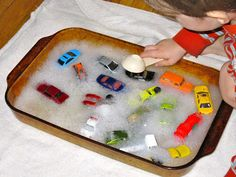 Put together this super simple bubble bath toy car wash for kids and keep them entertained and busy while you get your own work done!