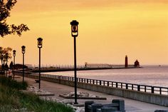 Walking or biking the boardwalk all the way out to the pier & lighthouse - Grand Haven, Michigan