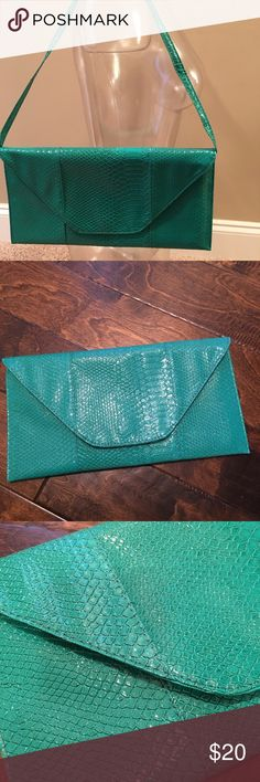 ‼️ Girls Night Out ‼️ This beautiful blue/green color staple piece is just what you need for your upcoming night out with the girls. It can be worn as a shoulder piece or simple carried around as an over sized clutch. Brand new without tags.   Measurements: 15 inches wide & 7 1/2 inches tall. 💚💙 Bags Clutches & Wristlets