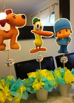 Pocoyo center pieces; some cut-outs and Lorena's awesome paper flower making skills and we're good to go haha!