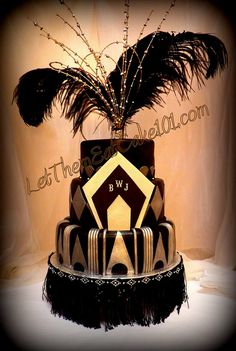 Black n Gold Love the fringing around the base and the design of the first layer. Perhaps something like this but with only one layer and the placard on the top with feathers? The fringing could sit on the cake stand