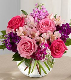 The FTD Tranquil Bouquet blooms with a sweet sophistication and style to bring a calming grace to any event or occasion. Hot pink and pink roses are brought together with purple, lavender and fuchsia stock stems accented with pink Peruvian lilies and lush greens to create a simply stunning flower arrangement. Presented in a clear glass bubble bowl vase, this exquisite fresh flower bouquet will make an excellent gift.