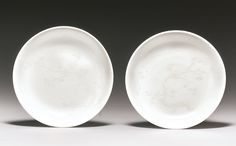 A rare pair of slip-decorated white-glazed dishes, Qing dynasty, 18th century