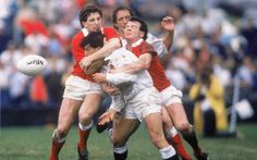 1987 Rob Andrew is tackled by Jonathan Davies and Ieuan Evans of Wales during England's quarter final defeat (Getty Images)