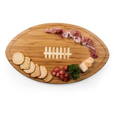 The Kickoff is the party platter and serving tray made especially for avid football fans. It's simple yet distinctive design features inlaid white bamboo to mimic the laces of a football and tapered sides for easy grasping. A recessed groove along the perimeter of the board catches cheese brine, fruit juices or au jus to keep your counter tops clean. The Kickoff will set the right mood for your next football-themed event.