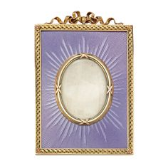 An important Faberge gold and enamel frame, the frame comprising an oval glass photograph pane with yellow gold surround, within a rectangular frame exquisitely laid with a fine lilac enamel with engine-turned background, all to an ornate yellow gold border with ribbon bow surmount, circa 1890. Lilac was the Tsarina's favourite colour.