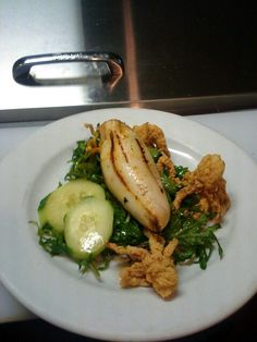 Grilled Stuffed Calamari, Baby Kale, Semolina Dusted Tentacle, Orange infused Red Wine Vinaigrette. Yummm...