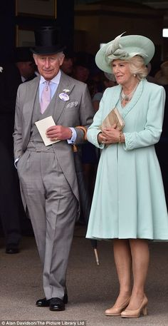 Charles, Prince of Wales and Camilla, Duchess of Cornwall, who was dressed in a pale green...