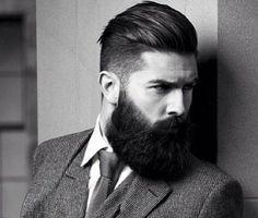 Abito nero per uomo barba