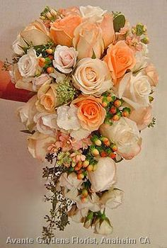 Peach bouquet of roses and hypericum