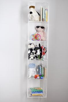Loving this lucite shelf for the nursery - tons of storage!