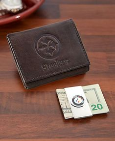 This NFL Wallet and Money Clip Set guards your cash, ID and cards. The trifold wallet has the team's name and logo embossed on the front. Inside are 8 cardholders, 4 clear cardholders, a clear ID pocket and a large pocket for bills. Money clip features t