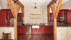 Kitchen in a barn home | Red Cabinets | Sand Creek Post & Beam  https://www.facebook.com/SandCreekPostandBeam?focus_composer=true&ref_type=bookmark