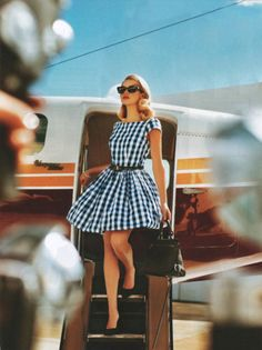 #racingstyle Style Inspiration: So chic and elegant also representing that retro style that I love. The flared out dress, the sunglasses and the hair...perfect.
