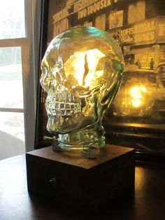 At R & R Home Design we spend a lot of time refurbishing and refinishing things, but sometimes we like to create something new. This is one of those times...  This skull lamp makes a statement! Meant for accent lighting, it provides a nice glow with an edge. An edison bulb shines from within this coke bottle glass skull globe that is bolted to a handcrafted wood base with a hand-rubbed aged finish. The lamp has an easy on and off chrome toggle switch on the front. The glow of light is har...