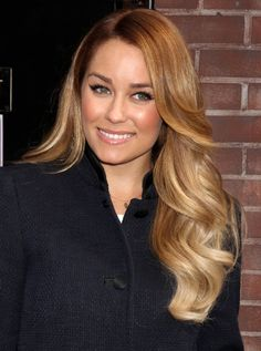 """The rich warm shades of Lauren Conrad's luxurious mane are meant to mimic the effects of the sun. Canalé recommends asking your colorist for two or three sets of delicate, layered highlights. """"Ask your colorist to pull your hair back and begin highlighting 1/16 inch from the hairline, depositing more color on the tips for sun-kissed ends."""""""