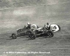 """Here is a wonderful action shot taken on May 30, 1937. The caption on the negative sleeve is """"Dinsmore hits Saylor"""". Duke Dinsmore in the #4 car creeps up and bumps Everett Saylor in the #2 car. This is an enlargement of a small portion of a 4x5 negative. My dad used several cameras covering the races but this image was made with one of those classic press cameras you see his hands on the front page of this site. There were no telephoto lenses in the 1930's."""