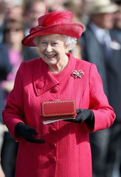 Queen Elizabeth II presents the Queen's Cup at the Cartier Queen's Cup Final at Guards Polo Club on June 16, 2013 in Egham, England,  Source: Chris Jackson/Getty Images Europe)