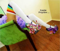 These ZombiePeepshow Sugar and Spice platform curved heel less wedges are customized with pyramid studs, large and small assorted crystals, spikes, mixed kawaii pieces, and glitter. They were hand painted and custom made for a client, so the final product you receive will have slight