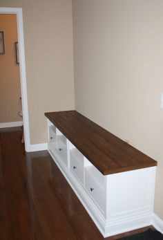 {THE CHARMING NEST}: {Mudroom Bench} - DIY from two IKEA Hemnes TV consoles. I love this, but still conflicted about whether we should add more 1920s Craftsman details to our house, or more of the Mid-Century Modern style we like.