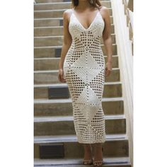 A LIMITED EDITION JAIDE DRESS. Kick start the new season in this stylish and effortlessly sexy knit crochet maxi dress. 100% Polyester. Halter cross back. No lining. A perfect bikini coverup.