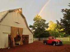 rustic, elegant, colorful wedding celebration in an old barn; antique car; wedding rainbow
