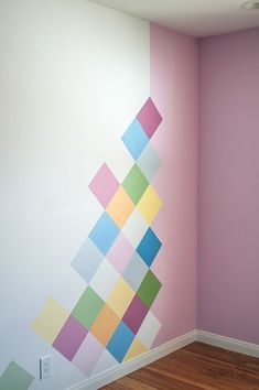 how to paint a shared boy and girl room. Anika is so talented look at the colorful girls accent wall idea How to paint a colorful accent wall. Step by step tutorial to easily paint a DIY geometric accent wall in under 6 hours. Perfect idea for kids room!