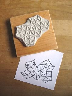 A hand-carved stamp with beautiful geometry.