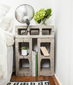 Upcycled Cinder Block Bedside Table from NY  b-4 Apartment..... note; Cinder blocks can be toxic, check b-4 bringing them into your home... Cool looking classic/standard aluminum clip-on light can be purchased at any hardware store 5 bucks + up depending on size...