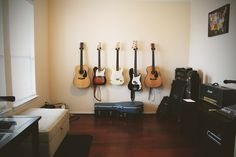 """Entry way """"formal living room"""" transformed into guitar room. Acoustic, electric, bass, & amplifiers all in one room! Best parts are the wall mounts for the guitars (14.99 each at guitar center). Could also be used as a home recording studio."""