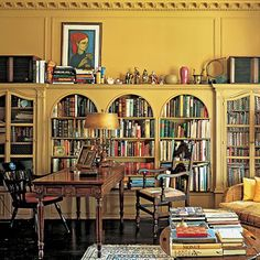 love the yellow and the arched bookcases