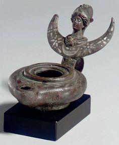 A ROMAN BRONZE OIL LAMP | CIRCA LATE 3RD CENTURY A.D.