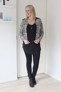 black skinny jeans black and white jacket black ankle boots