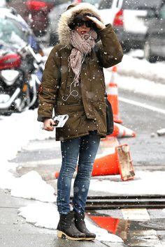 i love her, and that parka and those boots.