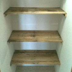 Another use for recycled pallets - pantry shelves. We converted a coat closet into a pantry using slats from recovered pallets. Winning!!