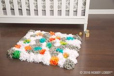 Attach DIY'd pompoms to a latch hook rug canvas to create just about the coziest thing your feet have ever felt! Diy Projects Videos, Yarn Projects, Latch Hook Rugs, Getting Ready For Baby, Little Blessings, Yarn Needle, Rug Hooking, Home Bedroom, Hobby Lobby