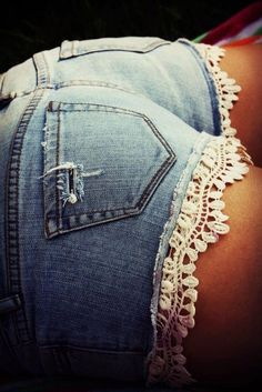 Easy DIY project buy a lace trim at your local craft store and just stitch it to the bottom of your shorts